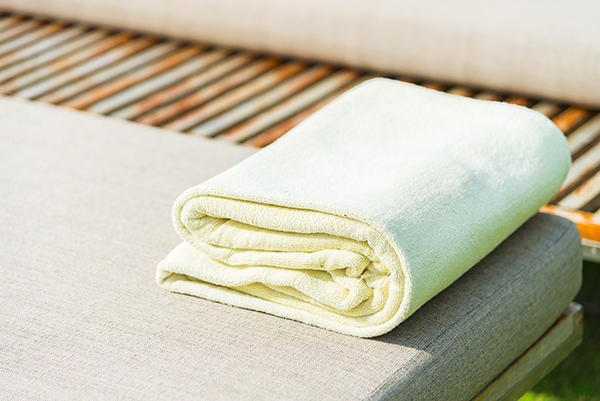 Pool towel on chair in luxury hotel resort